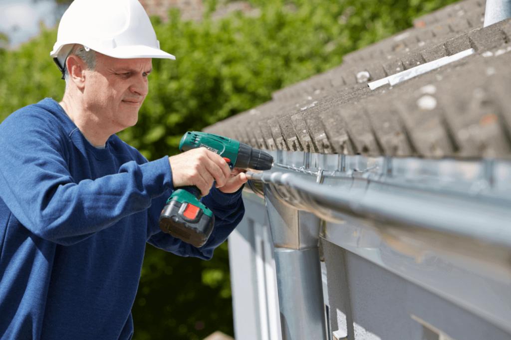 Gutterman installing gutters